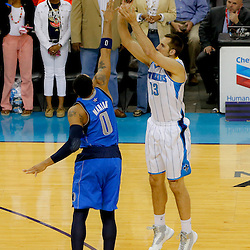 Apr 14, 2013; New Orleans, LA, USA; New Orleans Hornets power forward Ryan Anderson (33) shoots overDallas Mavericks small forward Shawn Marion (0) during the first quarter of a game at the New Orleans Arena. Mandatory Credit: Derick E. Hingle-USA TODAY Sports