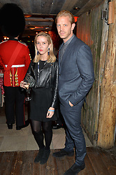 ALEXANDRA BERG and ALISTAIR GUY at Skiing With Heroes Junior Committee Awareness Party held at Bodo's Schloss, 2A Kensington High Street, London on 6th November 2014.