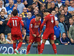 LONDON, ENGLAND - Sunday, September 22, 2019: Liverpool's Roberto Firmino (C) celebrates scoring the second goal with team-mate Virgil van Dijk during the FA Premier League match between Chelsea FC and Liverpool FC at Stamford Bridge. (Pic by David Rawcliffe/Propaganda)