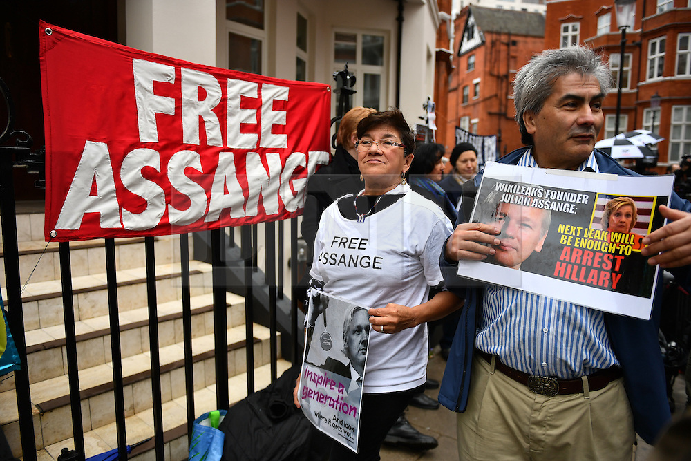 © Licensed to London News Pictures. 14/11/2016. London, UK. Pro Assange demonstrators gather as Swedish officials arrive at the Ecuadorian Embassy in London where they are expected to interview WikiLeaks editor-in-chief, Julian Assange. Assange, who has been living at the embassy for over four years, is wanted for questioning over accusations of rape in Stockholm in 2010.  Photo credit: Ben Cawthra/LNP