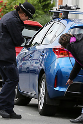 © Licensed to London News Pictures. 07/07/2019. London, UK. A woman shows blood stain on a car to the police officer parked opposite the victims house on Livingstone Road, Bounds Green in Enfield, North London where a woman and three girls were stabbed before noon on Saturday 6 July 2019. According to the Met Police, the condition of the woman, in her 30s, and two girls, both aged under 12 is now stable and non life-threatening after they were treated for serious stab wounds. The third victim aged 11, remains in a critical condition. A man has been arrested on suspicion of attempted murder.  Photo credit: Dinendra Haria/LNP