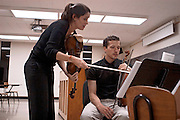 6. Kathryn Lockwood, the viola player for the Lark Quartet, works with Andrew Uhe, the 2nd violinist in a .graduate string quartet, during a master class at Ohio University in Glidden Hall on Wednesday, October .10th, 2007.