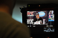 BIRMINGHAM, ENGLAND, NOVEMBER 3, 2011: Mark Munoz is pictured on a video monitor at the pre-fight press conference for UFC 138 inside the Hilton Hotel on November 3, 2011.