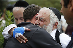 April 28, 2019 - Poway, CA, USA - Rabbi Yisroel Goldstein hugs a member of the congregation of Chabad of Poway the day after a deadly shooting took place there, on Sunday, April 28, 2019 in Poway, Calif. (Credit Image: © TNS via ZUMA Wire)