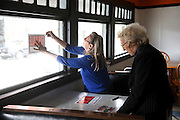 Sherry Greene, left, tapes a &quot;For Sale&quot; sign in the window of the Polka Dot Restaurant in White River Junction, Vt. for her mother Mary Shatney, the restaurant's owner, Thursday, April 30, 2015. Shatney bought the Polka Dot in the early 1980's, and Greene waitressed there in the 1970's.  (Valley News - James M. Patterson)<br /> Copyright &copy; Valley News. May not be reprinted or used online without permission. Send requests to permission@vnews.com.