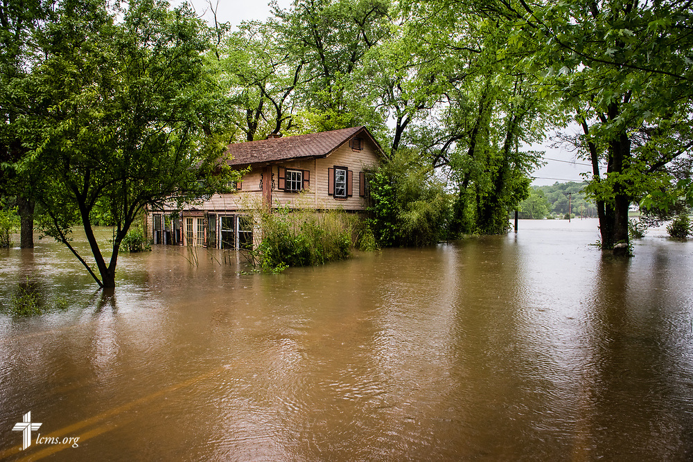 A flooded road and home on Wednesday, May 4, 2017, in Eureka, Mo. LCMS Communications/Erik M. Lunsford