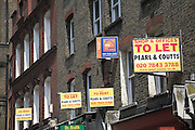 To Let signs for commercial property on Victorian terraced buildings, Leather Lane, London E4
