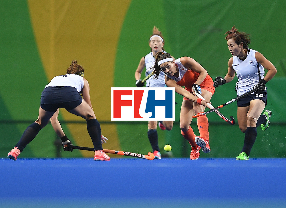 Netherland's Eva de Goede (C) hits the ball during the women's field hockey Netherlands vs South Korea match of the Rio 2016 Olympics Games at the Olympic Hockey Centre in Rio de Janeiro on August, 8 2016. / AFP / MANAN VATSYAYANA        (Photo credit should read MANAN VATSYAYANA/AFP/Getty Images)