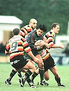 London Irish v Roma; Heineken Shield - Sat 18 Dec 1999..Exiles, centre, Robert Todd, breaking through the Roma defence. [Mandatory Credit: Peter Spurrier:Intersport Images.com]