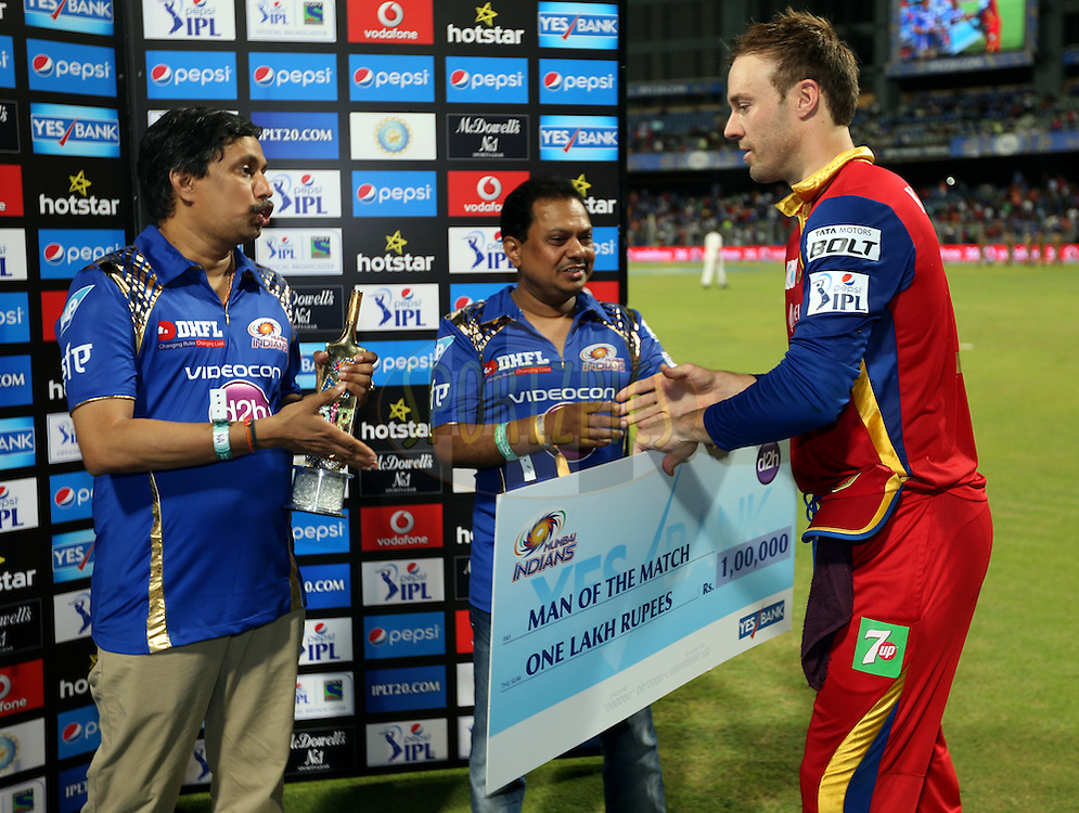 Royal Challengers Bangalore player AB De Villiers  receives the man of the match award during the presentation of the match 46 of the Pepsi IPL 2015 (Indian Premier League) between The Mumbai Indians and The Royal Challengers Bangalore held at the Wankhede Stadium in Mumbai, India on the 10th May 2015.<br /> <br /> Photo by:  Sandeep Shetty / SPORTZPICS / IPL