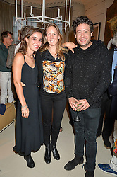 Left to right, LOLA ROSE THOMPSON, LARA BOGLIONE and ADAM WAYMOUTH at a party to celebrate the publication of 'A Girl From Oz' by Lyndall Hobbs held at Flat 1, 165 Cromwell Road, London on 12th May 2016.
