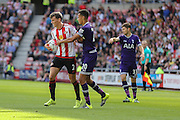 Sunderland Defender Billy Jones keeps the ball from Tottenham Hotspur midfielder Dele Alli during the Barclays Premier League match between Sunderland and Tottenham Hotspur at the Stadium Of Light, Sunderland, England on 13 September 2015. Photo by Simon Davies.