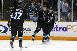 April 4, 2011; San Jose, CA, USA;  San Jose Sharks center Joe Pavelski (8) celebrates with center Kyle Wellwood (20) and center Torrey Mitchell (17) after scoring a goal against the Los Angeles Kings during the first period at HP Pavilion. Mandatory Credit: Jason O. Watson / US PRESSWIRE