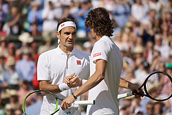 LONDON, ENGLAND - Tuesday, July 2, 2019: Roger Federer (SUI) shakes hands with Lloyd Harris (RSA) after the Gentlemen's Singles first round match on Day Two of The Championships Wimbledon 2019 at the All England Lawn Tennis and Croquet Club. (Pic by Kirsten Holst/Propaganda)