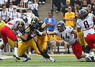 September 19, 2009: Iowa running back Brandon Wegher (3) tries to get by Arizona defensive end Ricky Elmore (44) during the Iowa Hawkeyes' 27-17 win over the Arizona Wildcats at Kinnick Stadium in Iowa City, Iowa on September 19, 2009.