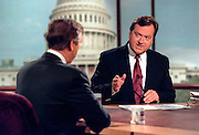 Host Tim Russert talks with Defense Secretary William Cohen August 23, 1998 during NBC's Meet the Press in Washington, DC.