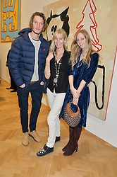 Left to right, FREDDIE PAGE, CARINA COOPER and her daughter ITHAKA RODDAM at the opening private view of 'A Strong Sweet Smell of Incense - A portrait of Robert Fraser, held at the Pace Gallery, Burlington Gardens, London on 5th February 2015.