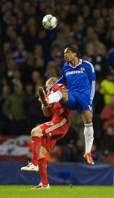 LIVERPOOL, ENGLAND - Wednesday, April 8, 2009: Liverpool's Martin Skrtel and Chelsea's Didier Drogba during the UEFA Champions League Quarter-Final 1st Leg match at Anfield. (Photo by David Rawcliffe/Propaganda)