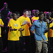"Kirk Franklin rehearses at U.S. Bank Arena on July 3rd, 2012. Artistic Coordinator for INTERKULTUR Kim Mann, Peace & Serenity Director Kenny Smith and a mass choir join Franklin to perform his song ""I Can,"" the official song of the 2012 World Choir Games."