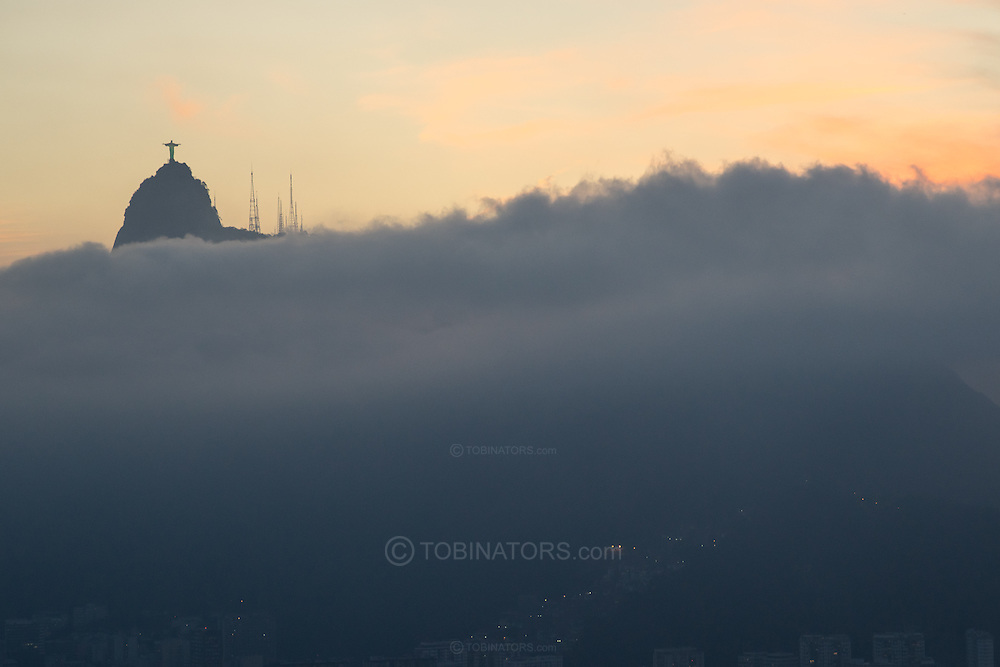 The Cristo Redemtor statue above the clouds at sunset in Rio de Janeiro, Brazil. Scenes from Rio de Janeiro on the day that Brazil drew 0-0 with Mexico. Photo by Andrew Tobin/Tobinators Ltd