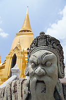 Golden Stupa and stone Guardian Wat Phra Kaew near the Royal Grand Palace Bangkok Thailand&#xA;<br />
