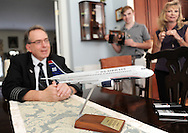 Larry Rooney speaks about his roll in the investigation of the accident involving US Airways Flight 1549 and a flock of geese and the subsequent film directed by Clint Eastwood with a replica airplane in the foreground as his wife Trish (right) and son LJ (center) stand by September 4, 2016 in Buckingham, Pennsylvania. (Photo by William Thomas Cain)