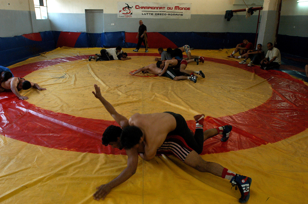 The Iraqi national wrestling team trains a the al-Kadhamiya Sports Club. Four members of the team will be competing at the Athens Olympics for the first time in decades..Baghdad, Iraq. 21/04/2004.Photo © J.B. Russell