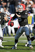 OAKLAND, CA - DECEMBER 19:  On a day in which he passed for a season high 371 yards and matched a career high 5 touchdown passes while completing 21 of 37 passes, quarterback Kerry Collins #5 of the Oakland Raiders gets ready to unload a pass against the Tennessee Titans at Network Associates Coliseum on December 19, 2004 in Oakland, California. The Raiders defeated the Titans 40-35. ©Paul Anthony Spinelli *** Local Caption *** Kerry Collins