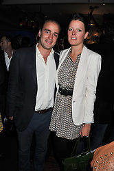 JAMES AMOS and his wife LAURA at a party to celebrate the opening of Bunga Bunga - a new Pizzeria & Bar, 37 Battersea Bridge Road, London SW11 on 1st September 2011.