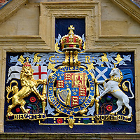 Coat of Arms above King's Manor in York, England<br /> This is the coat of arms for Charles I (1600 – 1649). His father, James I, was the first to combine the English lion and Scottish unicorn supporters with the Irish harp when he became king of all three in 1603. The United Kingdom's royal coat of arms still has a similar appearance. This heraldic symbol is above the door of King's Manor. This was the earliest site of the abbots' residence from St. Mary's Abbey. The first house was built in 1270. It was replaced with this 15th century building. It later was the Council of the North offices and then was the governor's house. It has been part of the University of York since 1963.