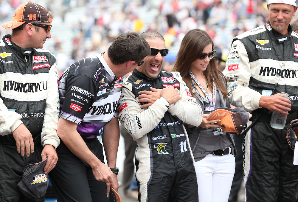 Indy 500 winner Tony Kanaan celebrates with his crew on the track following the 97th running of the Indianapolis 500 at Indianapolis Motor Speedway Sunday May 26, 2013. Chris Bergin/ for The Star