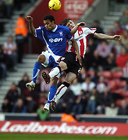 Photo: Jonathan Butler.<br />Southampton v Ipswich Town. Coca Cola Championship. 24/02/2007.<br />Chris Baird of Southampton jumps wtih Danny Haynes of Ipswich Town.