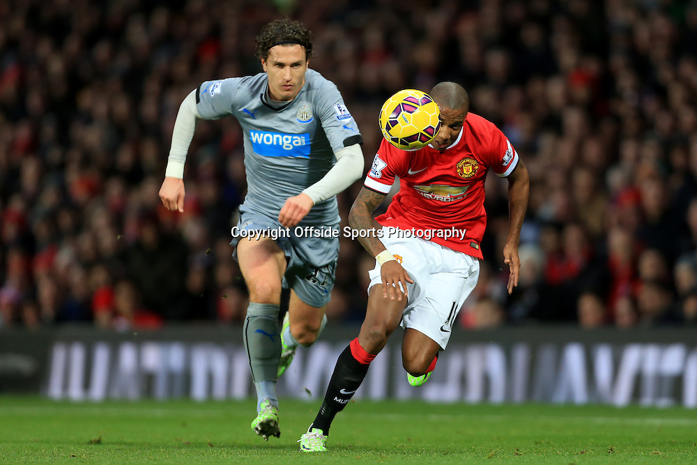26th December 2014 - Barclays Premier League - Manchester United v Newcastle United - Ashley Young of Man Utd battles with Daryl Janmaat of Newcastle - Photo: Simon Stacpoole / Offside.