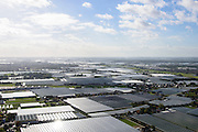 Nederland, Zuid-Holland, Gemeente Westland, 23-10-2013; Glazen stad, Kassengebied Westland, richting Naaldwijk.<br /> Greenhouses area in the West of the Netherlands, the heart of the production of vegetables and fruit for export. Between The Hague and Rotterdam<br /> luchtfoto (toeslag op standard tarieven);<br /> aerial photo (additional fee required);<br /> copyright foto/photo Siebe Swart