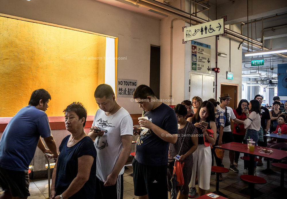 Singapore, queuing in Chinatown Complex Market & Food Centre-based stall for Hong Kong Soya Sauce Chicken Rice & Noodle,  the humble hawker stall now home to the world's cheapest Michelin-star meal