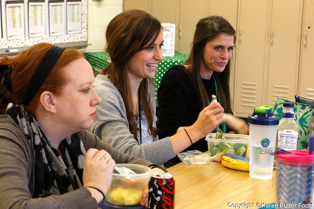 Memphis Teacher Resident Clarissa Pavey, center, has lunch and an opportunity for fellowship and community with others in the MTR program.  She is eating lunch with Shelby Stankavage (rt) a graduate of the program and Beth Mullin (left) a mentor. They are all at Memphis public school, Kingsbury Elementary.
