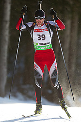 Simon Eder of Austria during the Men 20 km Individual of the e.on IBU Biathlon World Cup on Thursday, December 16, 2010 in Pokljuka, Slovenia. The fourth e.on IBU World Cup stage is taking place in Rudno Polje - Pokljuka, Slovenia until Sunday December 19, 2010.  (Photo By Vid Ponikvar / Sportida.com)