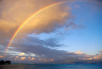 A rainbow over the overwater bungalows and lagoon in Moorea, French Polynesia