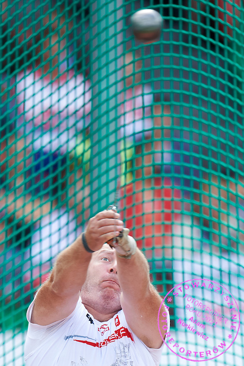 Szymon Ziolkowski of Poland competes in men's hammer throw final during the Fifth Day of the European Athletics Championships Zurich 2014 at Letzigrund Stadium in Zurich, Switzerland.<br /> <br /> Switzerland, Zurich, August 16, 2014<br /> <br /> Picture also available in RAW (NEF) or TIFF format on special request.<br /> <br /> For editorial use only. Any commercial or promotional use requires permission.<br /> <br /> Photo by &copy; Adam Nurkiewicz / Mediasport