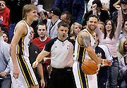 Utah Jazz forward Andrei Kirilenko, left, and Jazz guard Deron Williams, right, smile as they walk off the court at the conclusion of their NBA basketball game against the New York Knicks in Salt Lake City, Wednesday Jan. 12, 2011. Williams scored 24 points and Kirilenko scored 14 points in the Jazz' 131-125 win. (AP Photo/Colin E Braley)