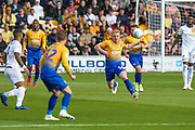 Willem Tomlinson (16) passes to Danny Rose (32) during the EFL Sky Bet League 2 second leg Play Off match between Mansfield Town and Newport County at the One Call Stadium, Mansfield, England on 12 May 2019.