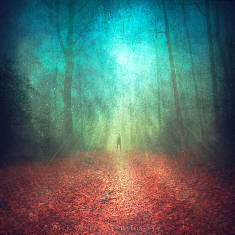 Ghostly figure in a colourful fall forest