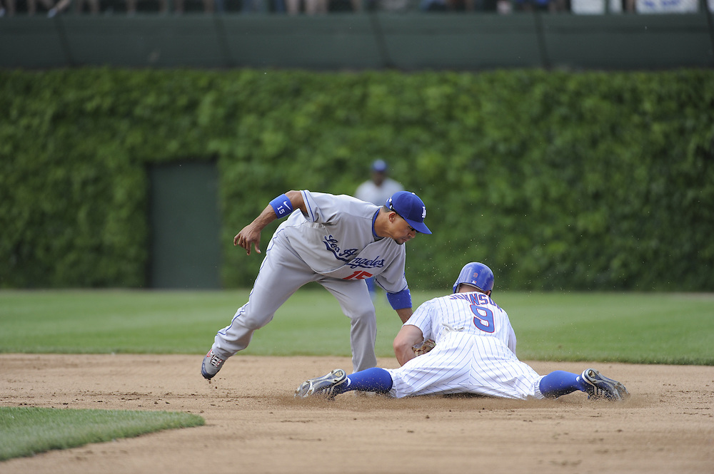 CHICAGO - MAY 30:  Reed Johnson #8 of the Chicago Cubs steals second base in the second inning against the Los Angeles Dodgers on May 30, 2009 at Wrigley Field in Chicago, Illinois.  The Cubs defeated the Dodgers 7-0.  (Photo by Ron Vesely)