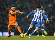 Cole Skuse and Joao Carlos Teixeira, Brighton midfielder during the Sky Bet Championship match between Brighton and Hove Albion and Ipswich Town at the American Express Community Stadium, Brighton and Hove, England on 21 January 2015.