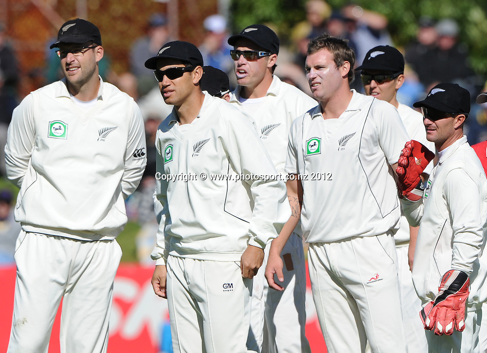 Doug Bracewell and team mates wait for the umpire referral decision to confirm the dismissal of Hashim Amla on Day 3 of the first test match between South Africa and New Zealand at the University Oval in Dunedin, New Zealand on Friday 9 March 2012. Photo: Andrew Cornaga/Photosport.co.nz