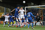 AFC Wimbledon striker James Hanson (18) battles for possession with Luton Town attacker James Collins (19) during the EFL Sky Bet League 1 match between AFC Wimbledon and Luton Town at the Cherry Red Records Stadium, Kingston, England on 27 October 2018.