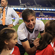 Abby Wambach, USA, signs autographs after becoming the greatest goal scorer in international soccer. Wambach scored four goals during the U.S. Women's 5-0 victory over Korea Republic, friendly soccer match. The four goals brings her tally to 160 goals which eclipsed Mia Hamm's all-time goal record of 158 goals.  Red Bull Arena, Harrison, New Jersey. USA. 20th June 2013. Photo Tim Clayton