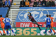 Ipswich Town's Bartosz Bialkowski tips one away during the EFL Sky Bet Championship match between Wigan Athletic and Ipswich Town at the DW Stadium, Wigan, England on 23 February 2019.
