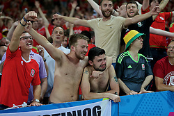 TOULOUSE, FRANCE - Monday, June 20, 2016: The emotion of Wales' 3-0 victory over Russia was too much for supporter Shaun Lawthom as he celebrates seeing his side reach the knock-out stage following the final Group B UEFA Euro 2016 Championship match at Stadium de Toulouse. (Pic by David Rawcliffe/Propaganda)