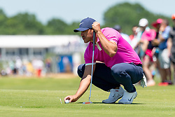 May 12, 2019 - Dallas, TX, U.S. - DALLAS, TX - MAY 12: Brooks Koepka lines up his putt on #6 during the final round of the AT&T Byron Nelson on May 12, 2019 at Trinity Forest Golf Club in Dallas, TX. (Photo by Andrew Dieb/Icon Sportswire) (Credit Image: © Andrew Dieb/Icon SMI via ZUMA Press)